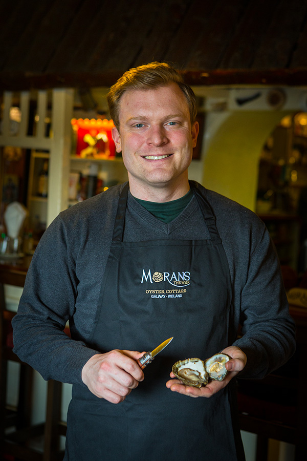 Michael Moran opening oysters
